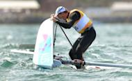 Australia's Tom Slingsby celebrates winning gold in the Laser sailing class at the London 2012 Olympic Games, in Weymouth