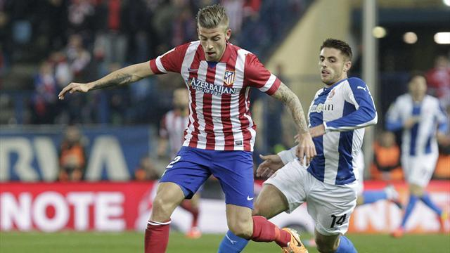 Liga - Nervy win over Espanyol keeps Atletico in touch with Real