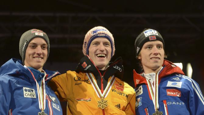 Schlierenzauer of Austria, Freund of Germany and Velta of Norway pose on the podium during the medal ceremony after the men's large hill ski jumping event (HS134) at the 2015 FIS Nordic Skiing World Championships in Falun
