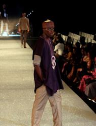 A model presents clothes from The Collection of Kola kuddus at The Arise Magazine Fashion Week at Victoria Island in Lagos, last month