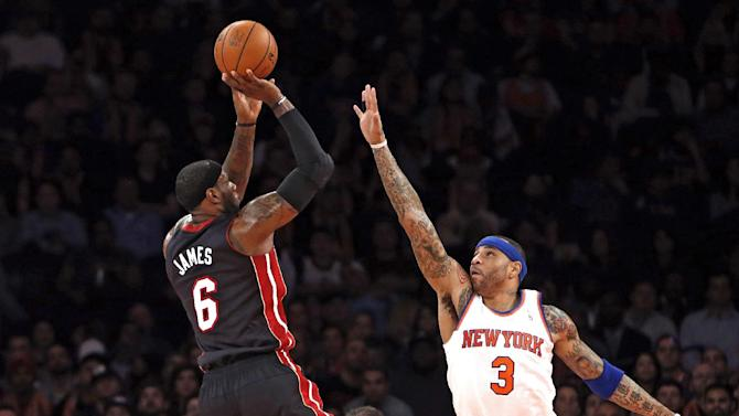 Miami Heat's LeBron James (6) shoots against New York Knicks' Kenyon Martin (3) during the first half of an NBA basketball game Saturday, Feb. 1, 2014, in New York