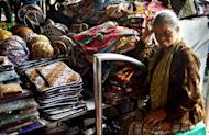 Every day is slow day: A senior batik vendor waiting for buyers near her stall. Batik is not only clothing, it could also be applied to a variety of craft items. (