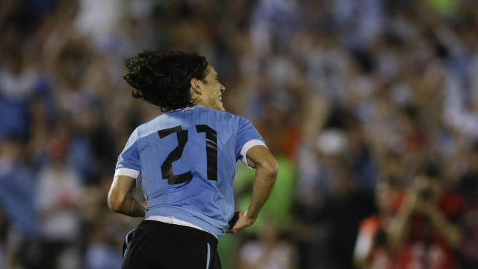 Uruguay's Edinson Cavani celebrates after scoring against Colombia during a 2014 World Cup qualifying soccer match  in Montevideo, Uruguay, Tuesday, Sept. 10, 2013. Uruguay won 2-0