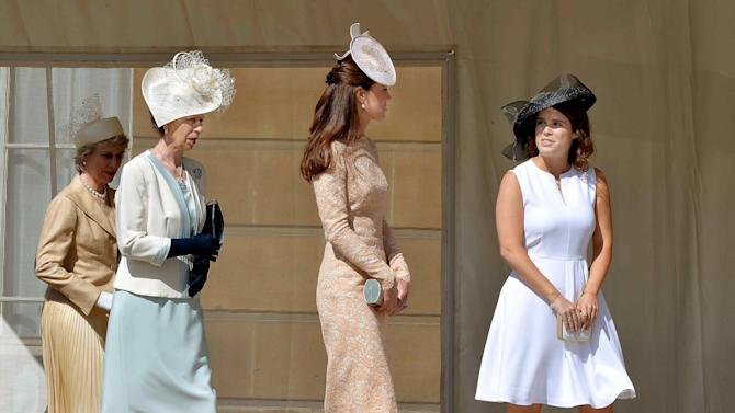 Britain's Duchess of Gloucester, Princess Anne, Catherine, Duchess of Cambridge and Princess Eugenie walk together during a garden party held at Buckingham Palace, in central London