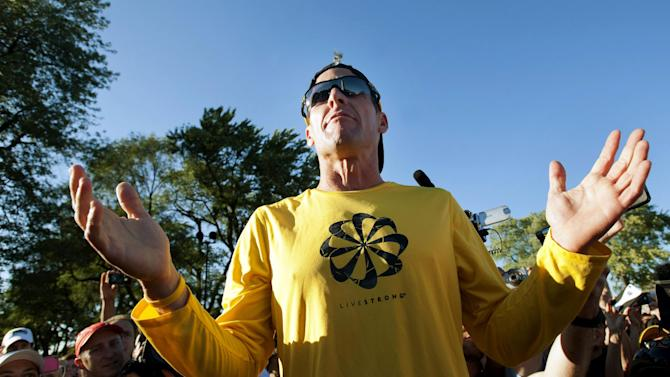 FILE - In this Aug. 29, 2012, file photo, Lance Armstrong talks to supporters prior to a run on Mont Royal Park in Montreal. Armstrong was diagnosed with cancer in 1996. Within minutes of Armstrong announcing he would step down as chairman of Livestrong, the foundation he created to support people with cancer, his longtime endorser Nike issued a statement saying it would be cutting sponsorship ties with the cyclist amid allegations of doping. Armstrong is said to be worth around $100 million, but most sponsors dropped him after USADA's scathing report _ at the cost of tens of millions of dollars. (AP Photo/The Canadian Press, Graham Hughes, File)