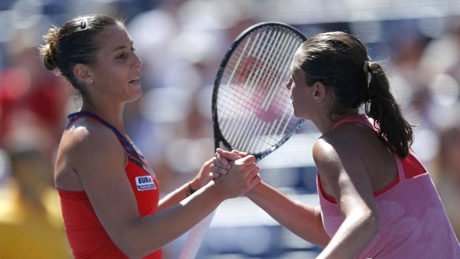 Pennetta of Italy is congratulated by compatriot Vinci after her victory at the U.S. Open tennis championships in New York