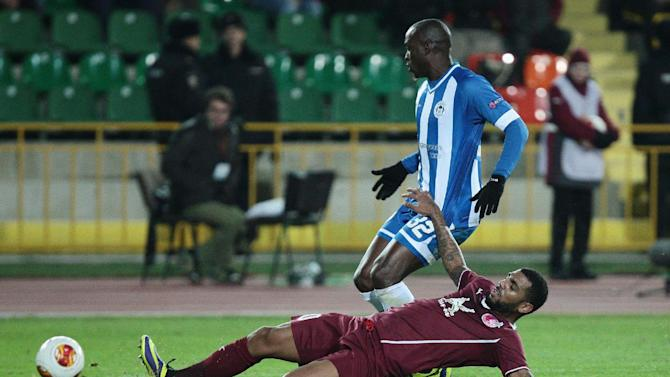 Rubin Kazan's Yann M'Vila, bottom, falls while fighting for a ball with Wigan Athletic's Marc-Antoine Fortune during their Europa League group D match in Kazan, Russia, Thursday Nov. 7, 2013