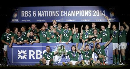 Ireland's players celebrate victory against France at the end of their Six Nations rugby union match at the Stade de France in Saint-Denis, near Paris