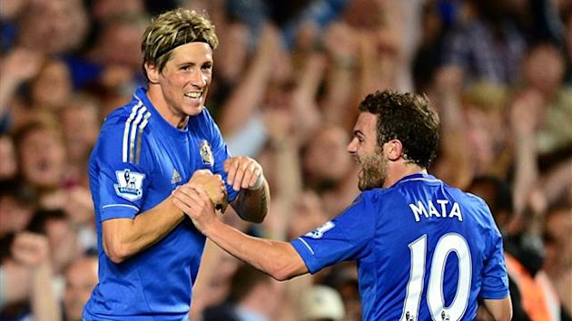 Chelsea's Fernando Torres (left) celebrates with team-mate Juan Mata after scoring his side's third goal against Reading in their Premier League match on August 22 (Reuters)