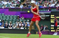 Empty seats can be seen behind Denmark's Caroline Wozniacki during her match against Briton Anne Keothavong during at the Wimbledon tennis club during the London Olympics on July 28. The organisers of the London Olympics faced a growing storm Sunday over blocks of empty seats at several venues, while British police were reportedly probing an alleged black-market scandal