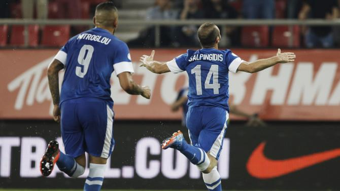 Greece's Salpingidis celebrates after scoring against Latvia during their 2014 World Cup qualifying soccer match in Piraeus near Athens