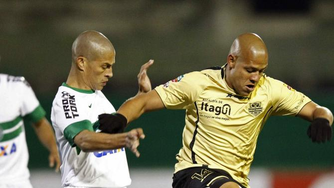 Alex of Brazil's Coritiba challenges Gustavo Bolivar of Colombia's Itagui during their Copa Sudamericana soccer match in Curitiba