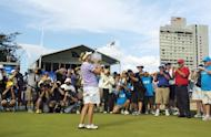This file photo shows Karrie Webb (C) of Australia posing with the trophy after winning the Ladies Masters tournament at the Royal Pines Resort, in Gold Coast, on February 11, 2007. Royal Pines has been the home of the Ladies Masters since 1992