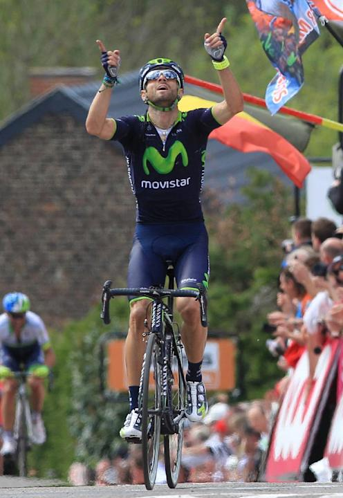 Spain's Alejandro Valverde of the Movistar team celebrates as he wins the Belgian cycling classic Walloon Arrow/Fleche Wallonne, in Huy, Belgium, Wednesday, April 23, 2014. Ireland's Daniel Ma