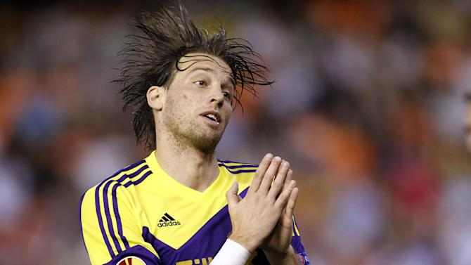 Swansea City's Michu from Spain  celebrates after scoring against Valencia during their  Europa  League Group A soccer match at the Mestalla stadium in Valencia, Spain, Thursday , Sept. 19, 2013