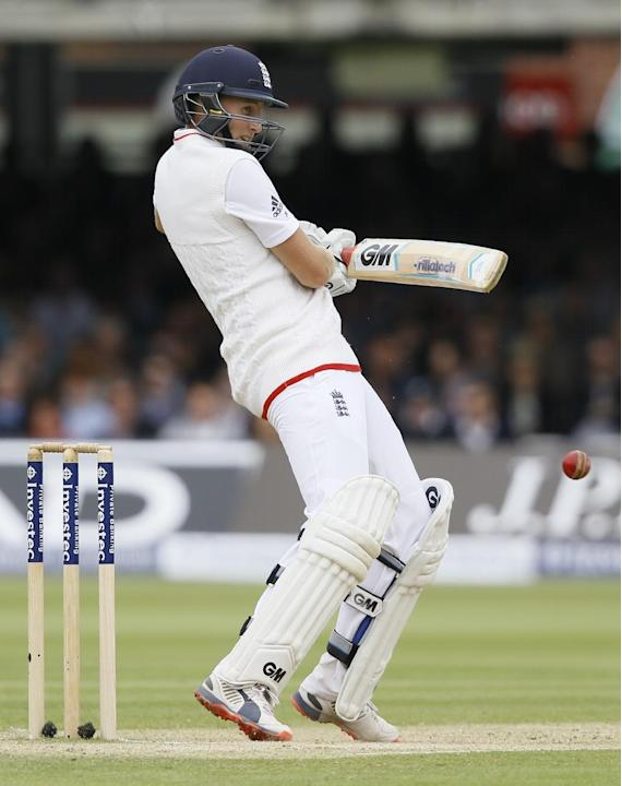 England's Joe Root plays a shot off the bowling of New Zealand's Corey Anderson during the fourth day of the first Test match between England and New Zealand at Lord's cricket ground in Lo