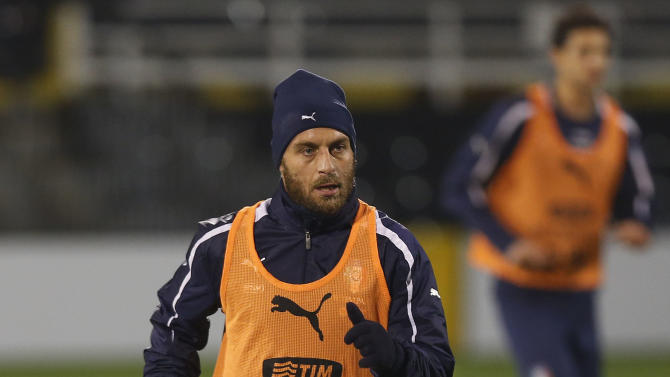 Italy's Daniele De Rossi runs during a training session at Craven Cottage in London, Sunday, Nov. 17, 2013. Italy is to play a friendly soccer match against Nigeria on Monday Nov. 18 at Craven Cottage in London