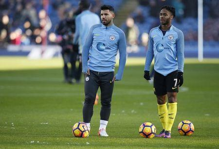 Manchester City's Sergio Aguero and Raheem Sterling before the match