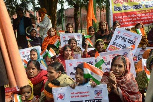 Indian demonstrators urge better safety for women following the rape of a student in the Indian capital, in New Delhi on December 26, 2012. India's government ordered a special inquiry Wednesday into the gang-rape.