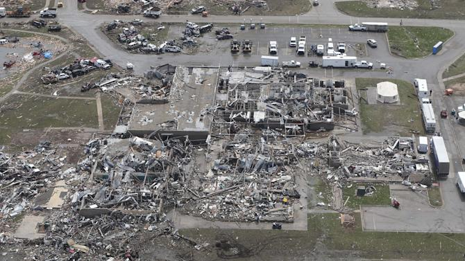 CORRECTS NAME OF SCHOOL TO BRIARWOOD ELEMENTARY INSTEAD OF PLAZA TOWERS ELEMENTARY - This Tuesday, May 21, 2013 photo shows wreckage of the Briarwood Elementary School in Moore, Okla., as seen from a National Guard helicopter during a tour of tornado damaged areas by Oklahoma Gov. Mary Fallin. (AP Photo/Sue Ogrocki, Pool)