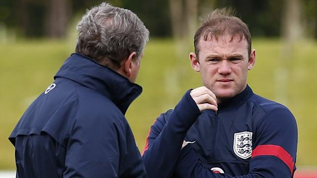 England's manager Roy Hodgson (L) speaks to Wayne Rooney during a training session at the St George's Park (Reuters)