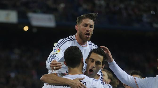 Real's Cristiano Ronaldo, centre, (7) cerebrates his goal with teammates during a semi final, 2nd leg, Copa del Rey soccer match between Atletico de Madrid and Real Madrid at the Vicente Calderon stadium in Madrid, Spain, Tuesday, Feb. 11, 2014