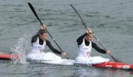 Austria's Yvonne Schuring (R) and Viktoria Schwarz compete in the kayak double (K2) 500m women's heats during the London 2012 Olympic Games, at Eton Dorney Rowing Centre in Eton, west of London, on August 7, 2012. AFP PHOTO / DAMIEN MEYER