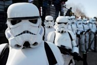"Star Wars Stormtroopers pose for photographers in Windsor, west of London, in March 2012. A new exhibit exploring human identity through the ""Star Wars"" universe and the epic sci-fi saga's quirky characters kicks off a multi-city world tour in Montreal on Thursday"