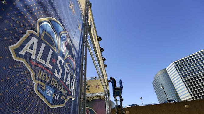 "FILE - In this Feb. 13, 2014, file photo, a worker attaches a banner to a scaffolding in New Orleans in preparation of the NBA All-Star basketball game. The league took the 2017 game out of Charlotte on Thursday, July 21, 2016,  because of its objections to a North Carolina law that limits anti-discrimination protections for lesbian, gay and transgender people. As the NBA looks for a new home for the 2017 All-Star Game, cities are lining up with open arms to welcome LeBron James, Stephen Curry and the hundred million or so dollars they would bring to the local economy. New Orleans is the favorite, with one official familiar with the discussions telling The Associated Press that the league and city are ""deep in negotiations"" to stage the game there for a third time.  (AP Photo/Gerald Herbert, File)"