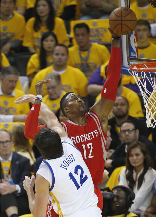 Houston Rockets center Dwight Howard, right, shoots against Golden State Warriors center Andrew Bogut during the first half of Game 5 of the NBA basketball Western Conference finals in Oakland, Calif.