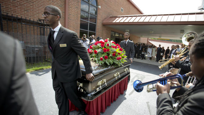 "The casket of Chris Kelly of the rap duo Kris Kross, is rolled to a waiting hearse following his funeral service, Thursday, May 9, 2013, in Atlanta. The 34-year-old Kelly was found dead May 1 of a suspected drug overdose. Kriss Kross was introduced to the music world in 1992 by music producer and rapper Jermaine Dupri after he discovered the pair at a mall in southwest Atlanta. Kelly performed alongside Chris Smith, who known as ""Daddy Mac."" (AP Photo/David Goldman)"