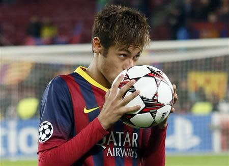 Barcelona's Neymar kisses the ball after scoring a hat-trick against Celtic as he leaves the pitch at the end of their Champions League soccer match in Barcelona