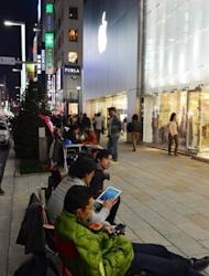 Japanese Apple fans queue outside an Apple store, waiting for the iPad mini to go on sale, in Tokyo on November 1. Apple's new iPad mini debuted on Friday with less fanfare than previous incarnations amid talk it might have come too late to the 7-inch tablet computer market