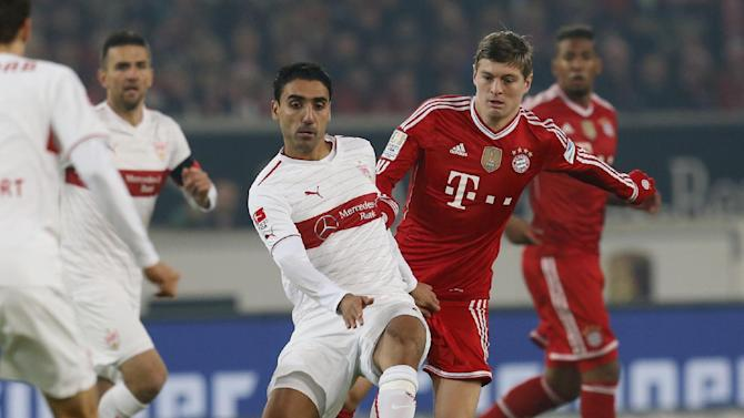 Stuttgart's Mohammed Abdellaoue of Norway, left, and Bayern's Toni Kroos challenge for the ball during a German first soccer division Bundesliga match between VfB Stuttgart and FC Bayern Munich in Stuttgart, Germany, Wednesday, Jan. 29, 2014