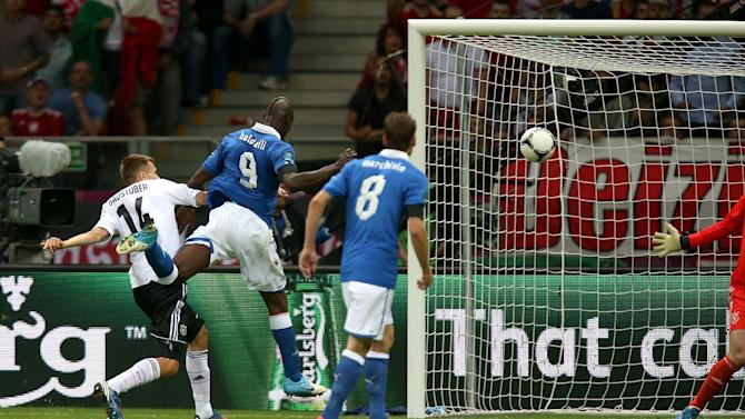 Italy's Mario Balotelli (centre) scores his side's first goal of the game