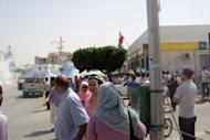 People look on as clouds of tear gas rise in a street in Sidi Bouzid, August 9. Police fired tear gas and rubber bullets to disperse a second anti-government protest in the central Tunisian town of Sidi Bouzid, birthplace of last year's revolution