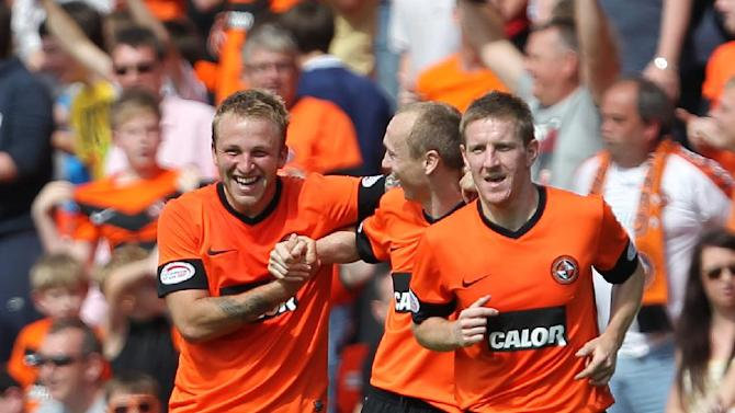 Johnny Russell is congratulated after scoring his second goal in the Dundee derby