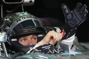 Mercedes Formula One driver Rosberg wears a glove as he sits in his car during the second practice session of the Malaysian F1 Grand Prix at Sepang International Circuit outside Kuala Lumpur
