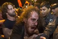 Eighty-five people were arrested in Tel Aviv overnight after scuffles between demonstrators and security forces following the detention of a social protest leader, police said on Sunday