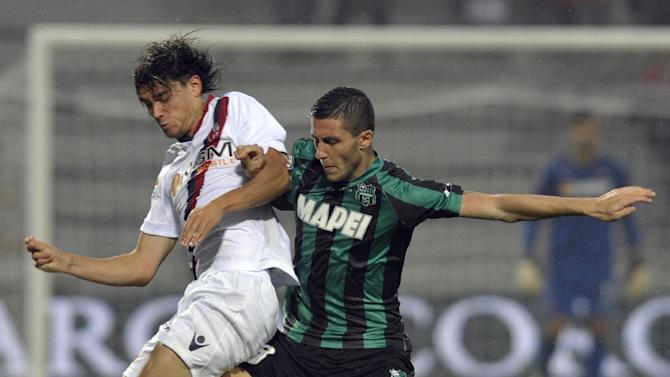 Sassuolo's Luca Marrone, right, vies for the ball with Bologna's Rene Krhin of Slovenia, during their Serie A soccer match at Reggio Emilia's Mapei stadium, Italy, Sunday, Oct. 20, 2013