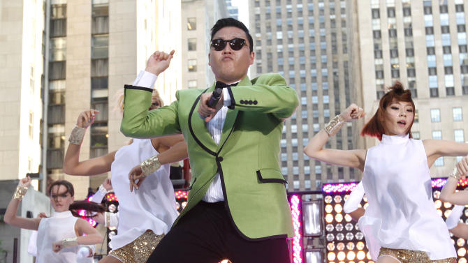 "In this photo taken on Sept. 14, 2012, South Korean rapper PSY performs his massive K-pop hit ""Gangnam Style"" live on NBC's ""Today"" show in New York. The ""Gangnam Style"" video has more than 200 million YouTube views and counting, and it's easy to see why. Gangnam is only a small slice of Seoul, but it inspires a complicated mixture of desire, envy and bitterness. It's also the spark for PSY's catchy, world-conquering song. (AP Photo/Invision via AP Images, Jason DeCrow)"