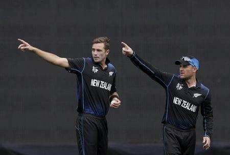 New Zealand's bowler Tim Southee and captain Brendon McCullum discuss fielder placement during their Cricket World Cup semi final against South Africa in Auckland