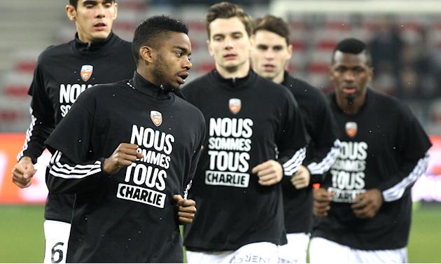 "Lorient's Yoann Watcher wears a T-shirt reading ""We are all Charlie"" for victims of the shooting at the satirical newspaper Charlie Hebdo, Saturday, Jan. 10, 2015, in Nice stadium, southeastern France"