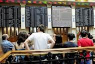 People are seen watching screens at Madrid's Stock Exchange, in 2011. Investors showed deep concern ahead of a Spanish government bond auction due Thursday, fearing Madrid could be thrown back into the centre of the eurozone debt crisis