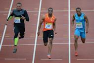 L-R: US athlete Ryan Bailey, US athlete Tyson Gay and Jamaica's Michael Frater compete in the men's 100m final at the 2012 Diamond League athletics meet at Crystal Palace in London. Gay shrugged off damp and cold conditions to power to victory in the 100m at the London Diamond League meeting