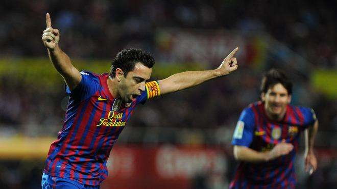 Barcelona's Midfielder Xavi Hernandez Celebrates AFP/Getty Images