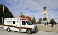 An ambulance is pictured alongside the Canadian War Memorial following a shooting incident in Ottawa October 22, 2014. REUTERS/Chris Wattie