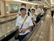 A group of Chinese tourists arrive at Taiwan's Taoyuan airport in 2008. Taiwan, which is seeing a boom in tourism from China, will spend Tw$463 billion ($15.4 billion) on a new terminal at Taoyuan airport