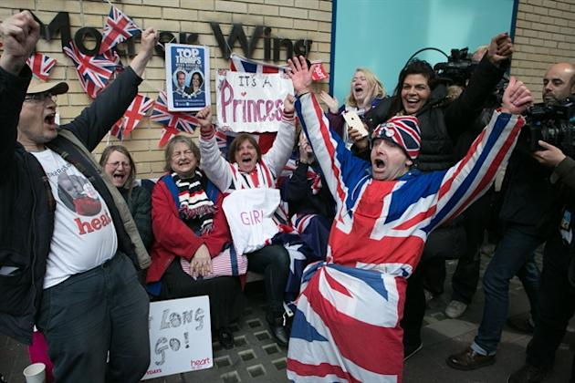 "Royal fans and well wishers react after Kensington Palace announced that Kate, the Duchess of Cambridge, had given birth to a girl, outside the Lindo Wing of St. Mary's Hospital, London, Saturday, May 2, 2015. Kensington Palace said in a brief statement that Prince William's wife ""was safely delivered of a daughter"" at 8:34 a.m. London time (0734 GMT), less than three hours after she was admitted to central London's St. Mary's Hospital. (Daniel Leal-Olivas/PA via AP) UNITED KINGDOM OUT, NO SALES, NO ARCHIVE"