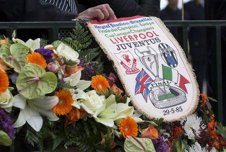 A fan of Juventus soccer team displays a commemorative banner during a ceremony at the King Baudouin Stadium commemorating the 30th anniversary of the Heysel Stadium disaster in Brussels